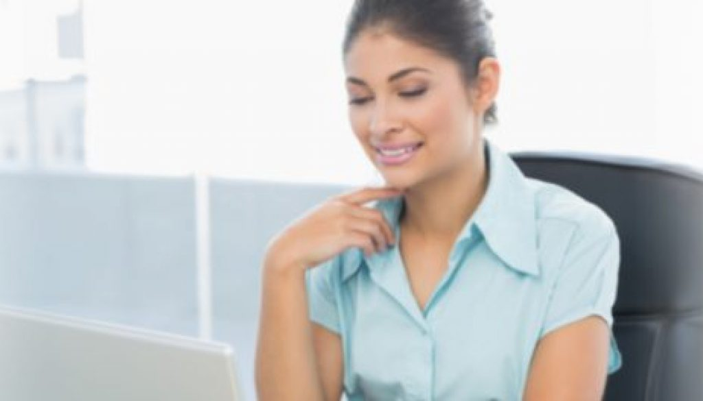 Smiling Accountant working on computer